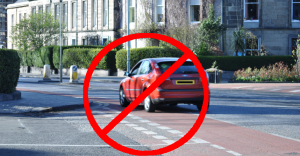 Car driving in the cycle lane