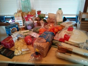 Groceries spread across the dining table